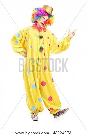 Full length portrait of a cheerful clown in a yellow costume isolated on white background