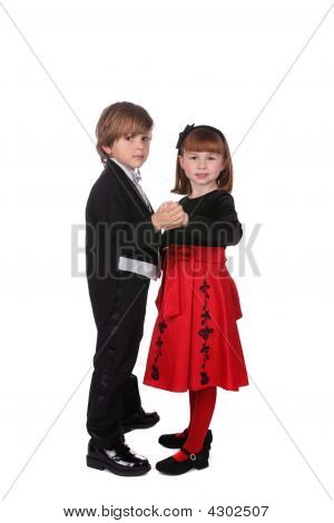 Cute Young Children Dancing Togther In Formal Clothing
