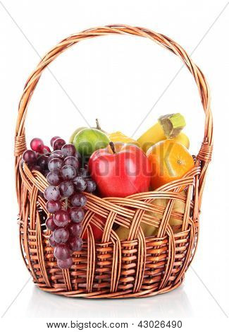Different fruits in wicker basket isolated on white