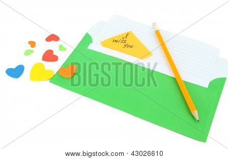 Note in envelope with pencil isolated on white