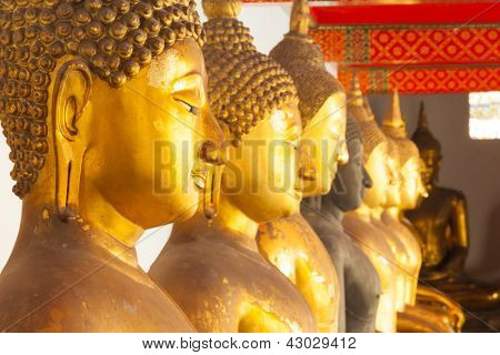 BANGKOK - MARCH 16. Buddha statues in the Wat Pho temple on March 16, 2012 in Bangkok, Thailand. Wat Pho is named after a monastery in India where Buddha is believed to have lived.