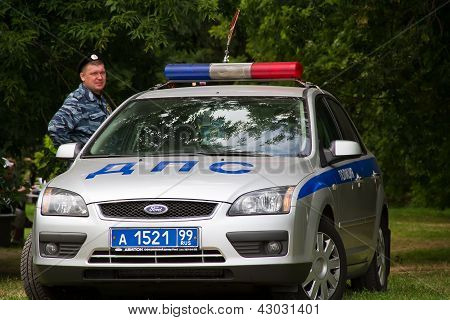 Russian Police Officer With A Police Car