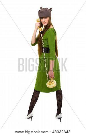 Beautiful fashion woman holding a  vintage phone