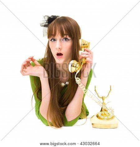Beautiful fashion woman holding a  vintage phone