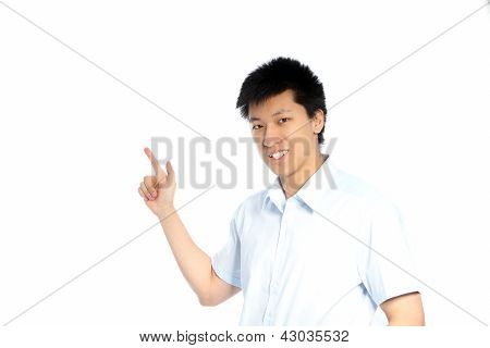 Asian Man Pointing To Blank Copyspace