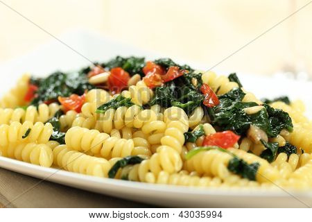 Italian pasta with vegetables and spinach