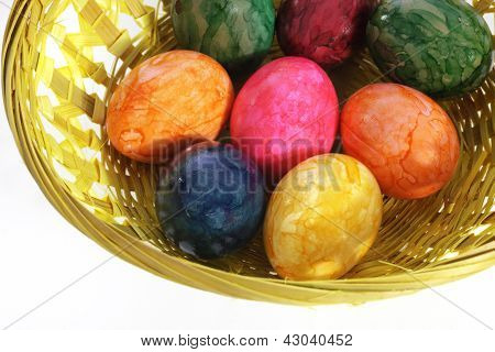 Colourful Painted Easter Eggs In A Basket