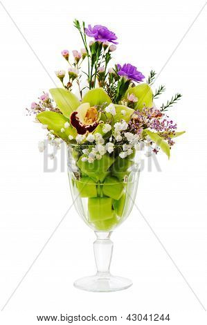 Floral Bouquet Of Orchids, Roses And Carnation Arrangement Centerpiece In Glass Vase Isolated On Whi