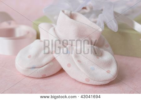 Pink spotted baby bootees
