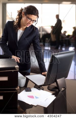 Businesswoman In Bank Lobby