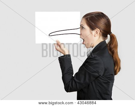 Woman holding a  paper sheet with a sketch of pinnochio nose on it