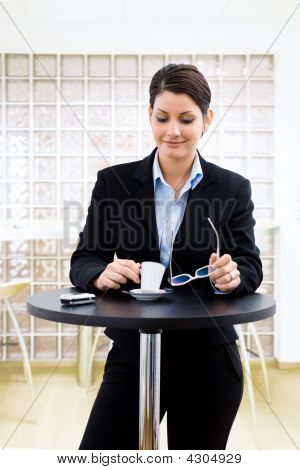 Businesswoman Having Coffee Break