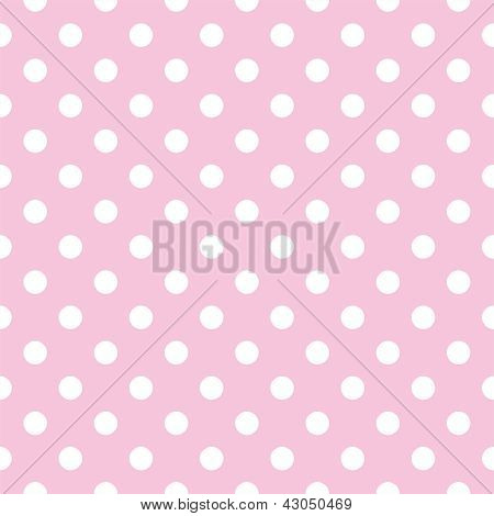 Seamless vector pattern with white polka dots on a pastel pink background