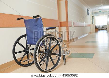 Wheelchair for patient moving standing in corridor of modern cardiology clinic hospital