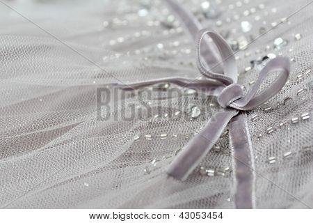 Velvet bow and beads dress detail