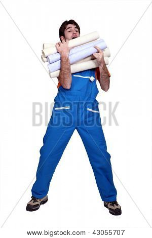 Man laden with rolls of wallpaper