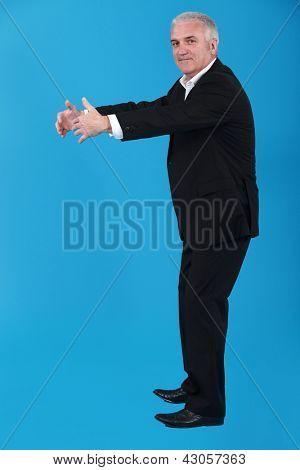 Businessman pretending to give hug
