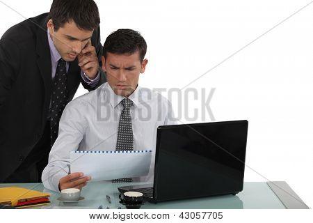 Perplexed business professionals