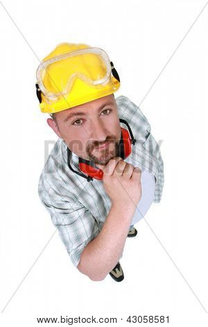 Manual worker with goggles and hearing protection
