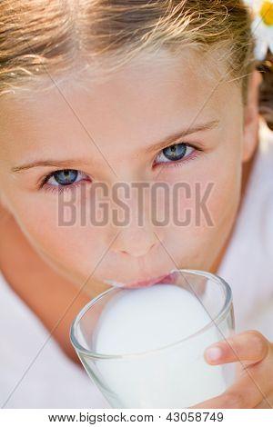 Healthy kid, milk - Portrait of lovely girl drinking fresh milk