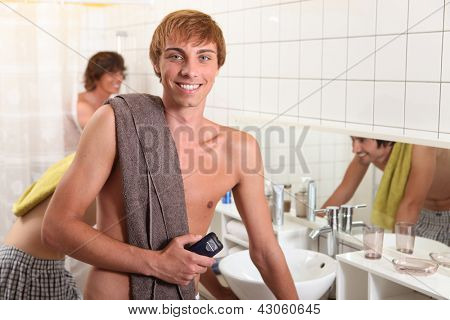 Young man in a shared bathroom