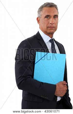 Businessman holding a blue folder