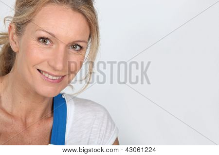 Close up of a woman in blue dungarees