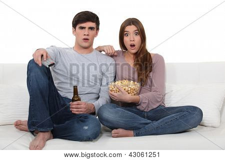 Couple on sofa with popcorn