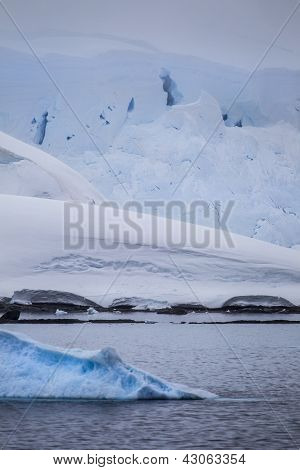 Antarctic Icebergs In Forground
