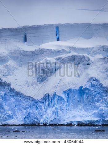 Antarctic Iceberg With Blue Reflection
