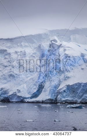 Iceberg Covered With Drifting Snow