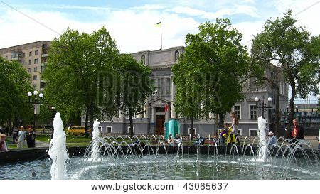 people having a rest in park with fountains in the central part of Chernihiv