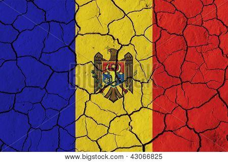Flag Of Moldova Over Cracked Background
