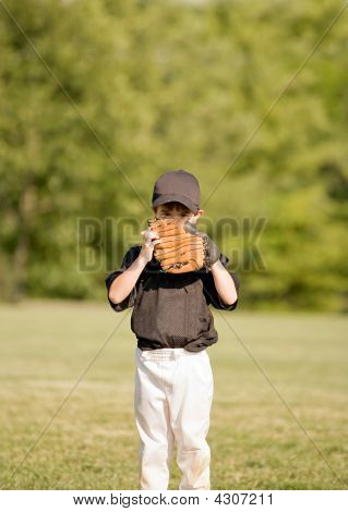 Little Boy Hiding Behind His Glove