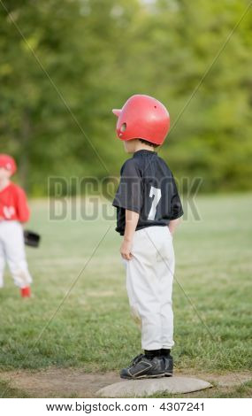 Little Base Runner On First Base