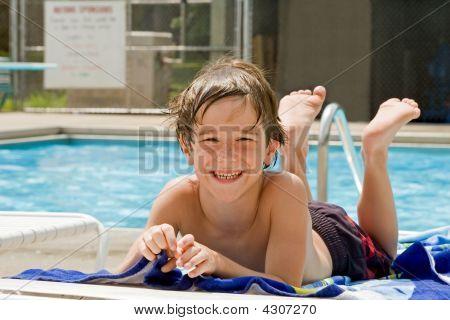 Boy Having Fun At The Pool