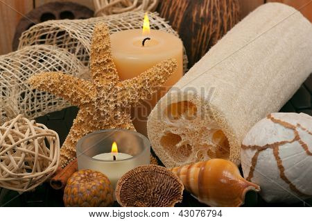 Spa concept with aromatic candles, decorations and loofah