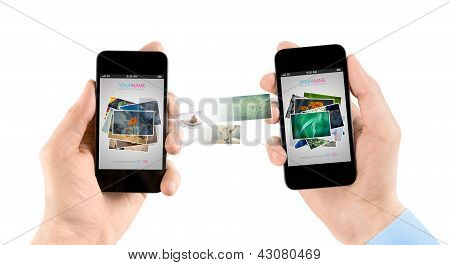 Mobile Smart Phones While Transferring Pictures