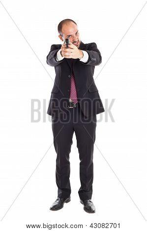 Businessman Standing With A Gun