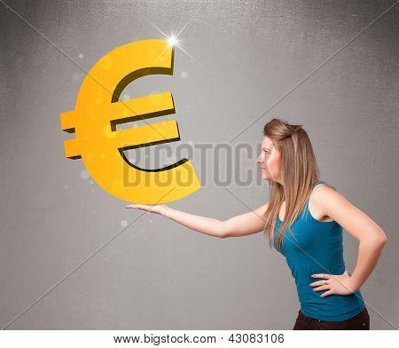 Menina segurando um grande sinal de euro ouro 3d