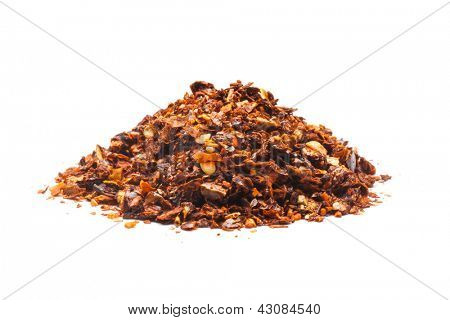 Dried red pepper flakes, isolated on white.