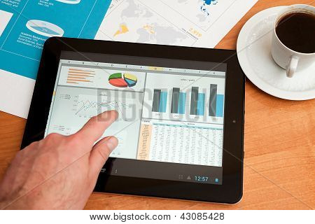 Desk With Digital Tablet. Marketing Research.