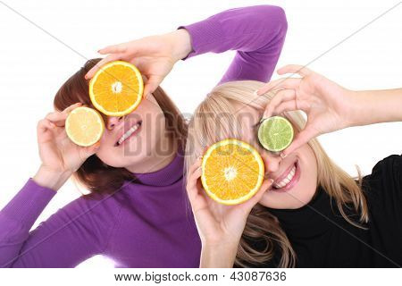 Two Funny Women With Orange And Lime Slices Instead Of Eyes