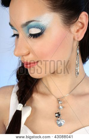 Close Up Portrait Of Beautiful Woman With Winter Make-up