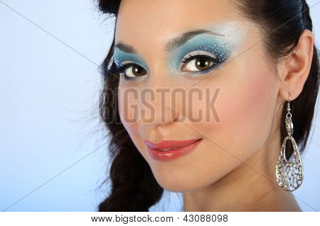 Close Up Portrait Of Beautiful Woman With Blue Make-up