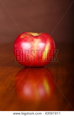 Single Apple On Table With Reflection