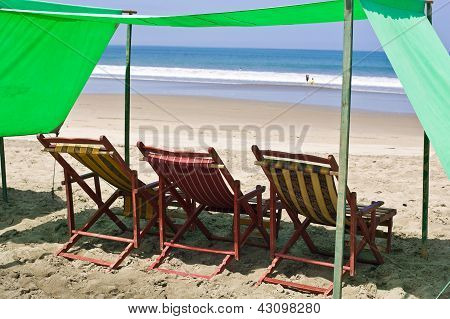 Beach Chairs On Sandy Beach