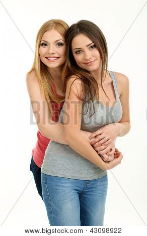 Two girl friends hugging isolated on white