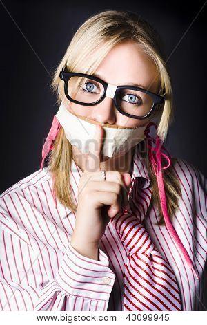 Female Business Nerd With Quiet Gesture