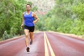 Running athlete man. Male runner sprinting during outdoors training for marathon run. Athletic fit y